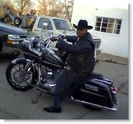 Black Dragon sitting on a Harley Davidson