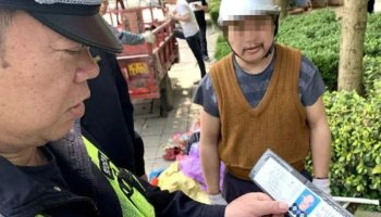 Motorcyclist Qin is rumbled by a police officer in Liuzhou city, Guangxi, for riding on a fake licence and it emerged he had been doing so for months. Photo: Liuzhou Traffic Police