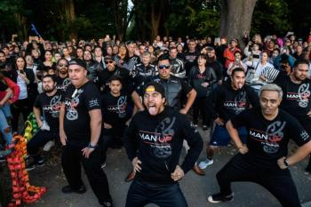 Members of different biker gangs perform the haka as a tribute to victims in Christchurch, New Zealand, on March 20, five days after the twin mosque shootings. The Mongrel Mob gang said it would not give up its weapons set to be banned in the wake of the attack. ANTHONY WALLACE/AFP/GETTY IMAGES