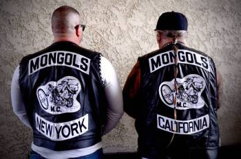 The first-of-its-kind effort to convict the Mongols organization, rather than specific members, of racketeering in order to strip members of their well-known insignia is almost certain to make its way before the Ninth Circuit Court of Appeals and possibly to the U.S. Supreme Court. Above, motorcycle club members rally Saturday, March 29, 2013 at The House Lounge in Maywood in support of the Mongols who are facing a federal trial seeking to take away their trademark patch. (Photo by Sarah Reingewirtz/Pasadena Star-News)